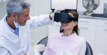 Female patient virtual reality headset during a dental visit at dental clinic